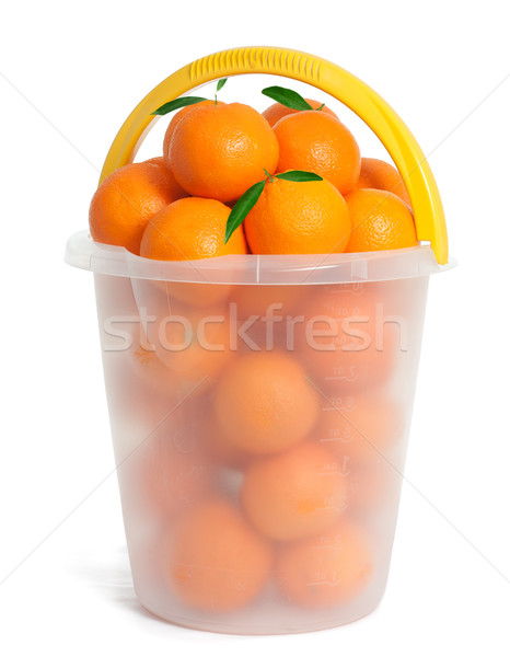 Műanyag vödör narancs gyümölcsök étel zöld Stock fotó © leventegyori