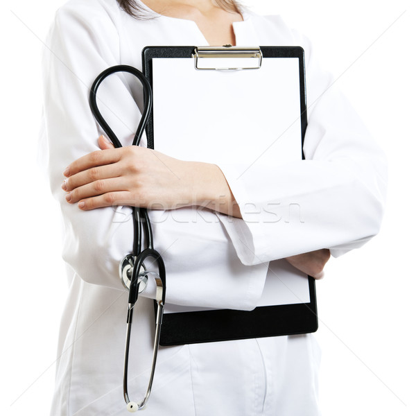 Mujer médico aislado vacío portapapeles mano Foto stock © leventegyori