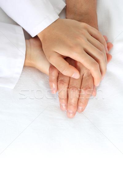 Nő tart idős kéz ágy boldog Stock fotó © leventegyori