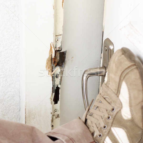 Burglar breaking into a house with foot Stock photo © leventegyori