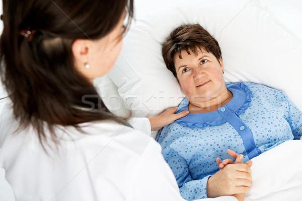 Doktor hasta ev hastane çalışma hemşire Stok fotoğraf © leventegyori