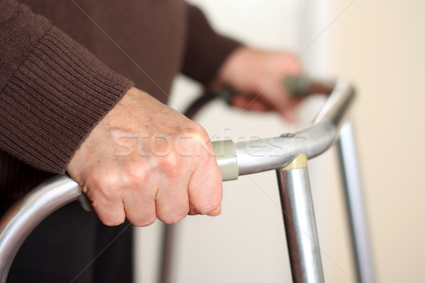 Senior using a walker Stock photo © leventegyori