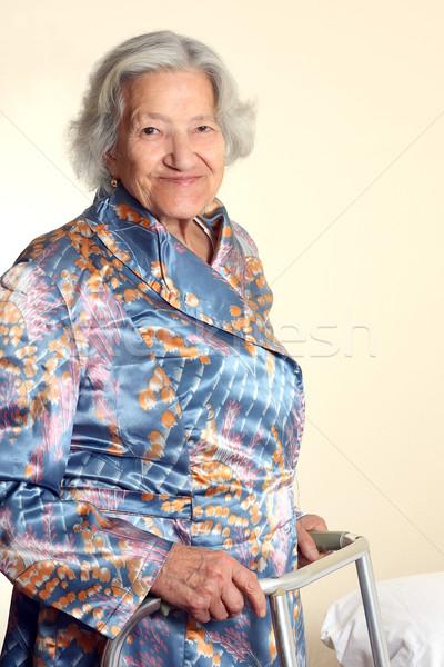 Senior woman using a walker Stock photo © leventegyori