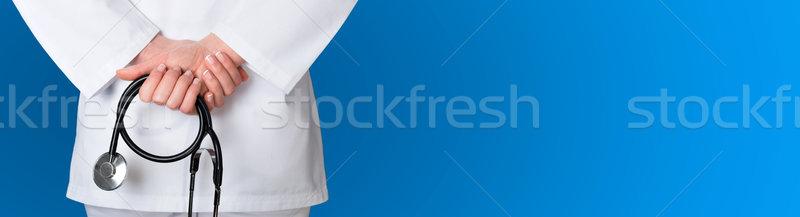 Orvosi kék sztetoszkóp kéz otthon háttér Stock fotó © leventegyori