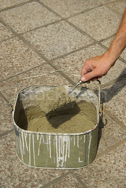 Bouwen hand cement plaats klusjesman Stockfoto © LianeM