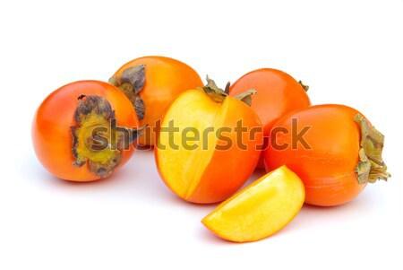 Японский хурма 16 фрукты фон красный Сток-фото © LianeM