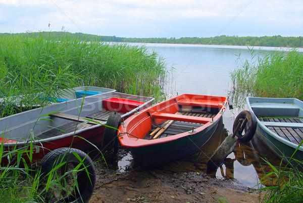 Evezős csónak természet zöld kék tó folyó Stock fotó © LianeM