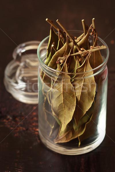 Laurel hojas picante vidrio olla oscuro Foto stock © lidante