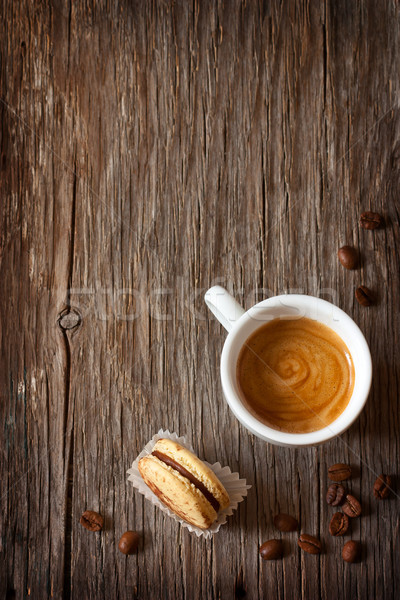 Morning cup of espresso coffee with macaron on a wooden background with copy space. Stock photo © lidante
