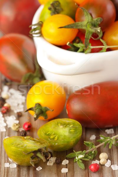 Paradicsomok színes só fa deszka étel narancs Stock fotó © lidante