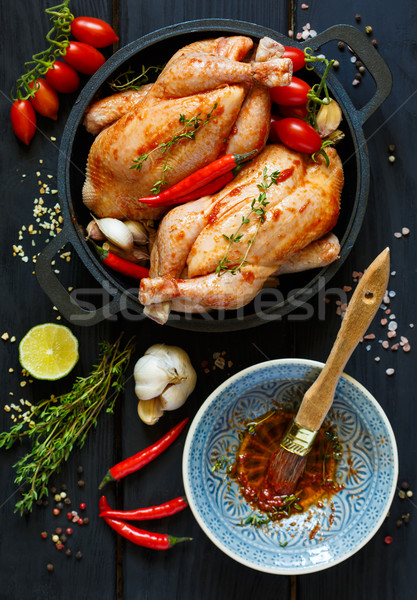 Preparation for roasting chicken with herbs Stock photo © lidante