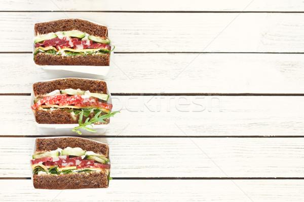 Délicieux sandwiches salami blanche papier alimentaire Photo stock © lidante