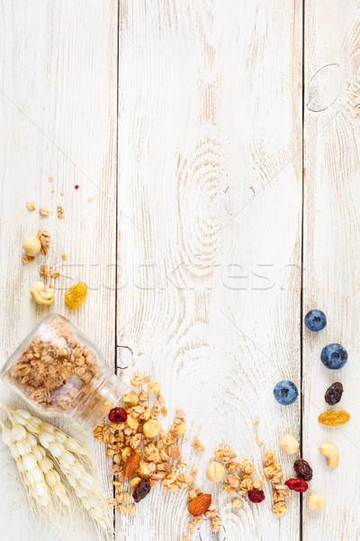 Casero granola jar arándanos nueces luz Foto stock © lidante