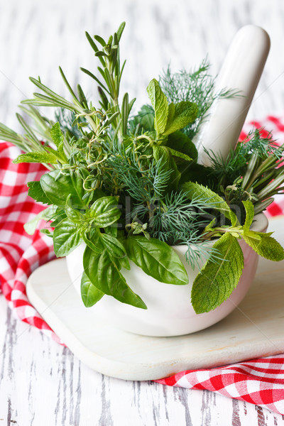 Mortar and herbs. Stock photo © lidante