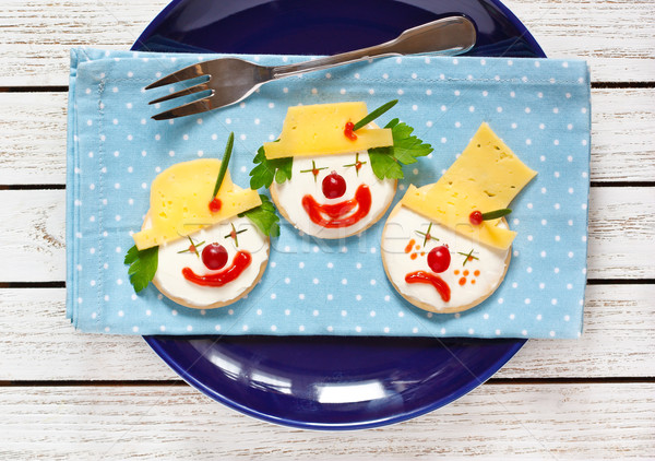 Funny cheese crackers. Stock photo © lidante