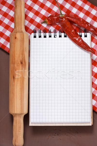 Kulinarny notebooka wałkiem tkaniny czerwony Zdjęcia stock © lidante