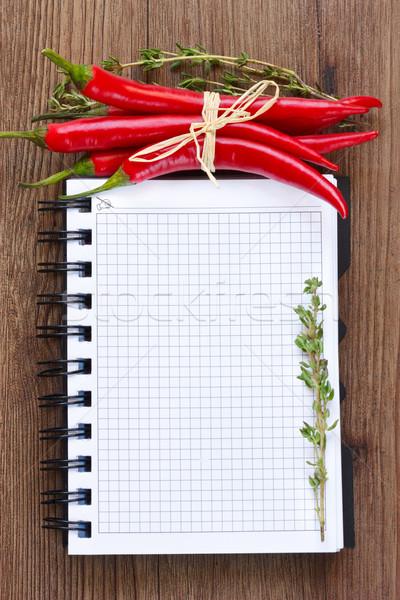 Książka kucharska notebooka czerwony chili papieru Zdjęcia stock © lidante