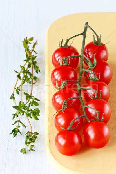 Cherry tomatoes and thyme. Stock photo © lidante