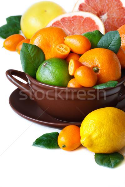 Citrinos colorido marrom cerâmico tigela comida Foto stock © lidante