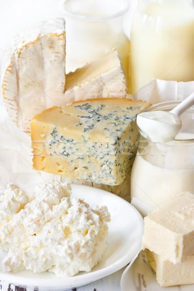 Tejtermékek fehér fa deszka étel kék csoport Stock fotó © lidante