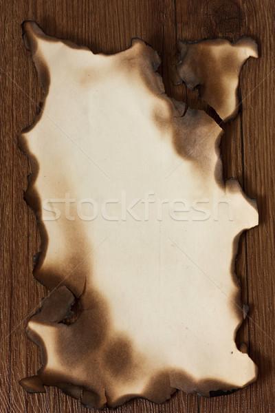 Pergamino papel mesa de madera fuego arte Foto stock © lidante