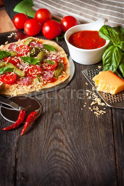 Pizza ev yapımı salam kiraz domates ahşap bo Stok fotoğraf © lidante