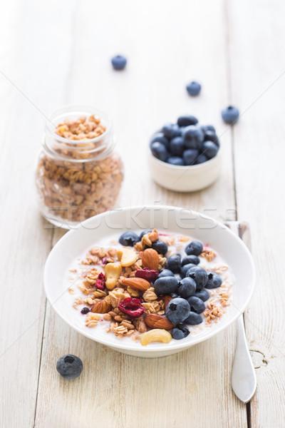 Granola yogurt desayuno casero frutas nueces Foto stock © lidante