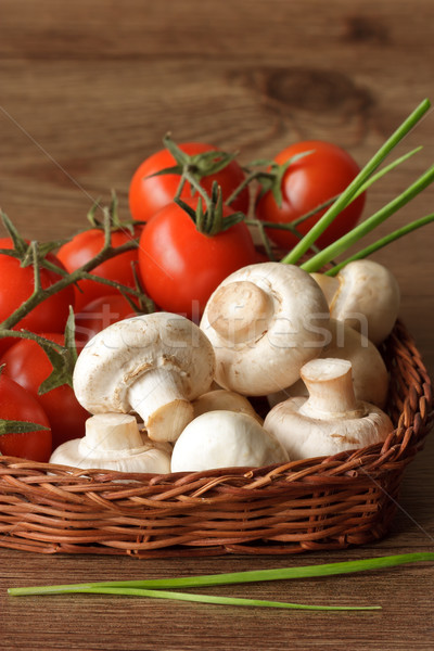 Champignons and cherry tomatoes. Stock photo © lidante
