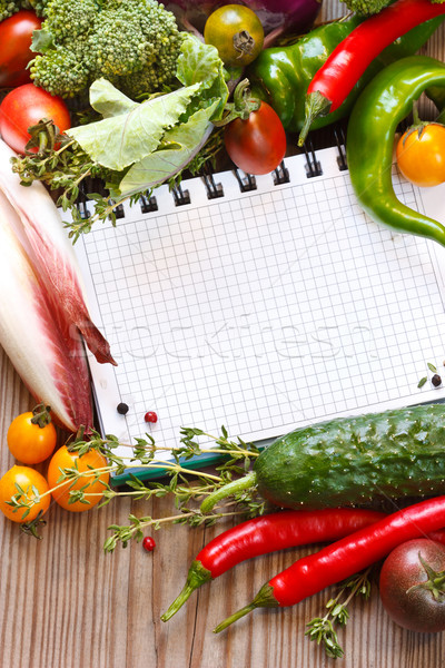 Stock photo: Notebook and  vegetables.