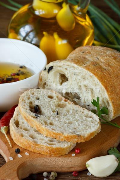 Fresco pão aromático azeite ervas temperos Foto stock © lidante