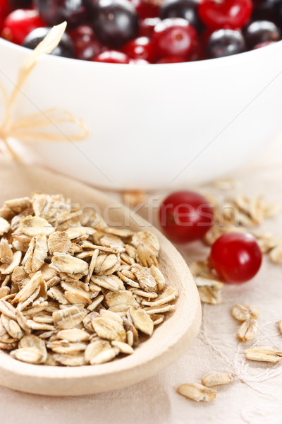 Oat flakes and berries. Stock photo © lidante