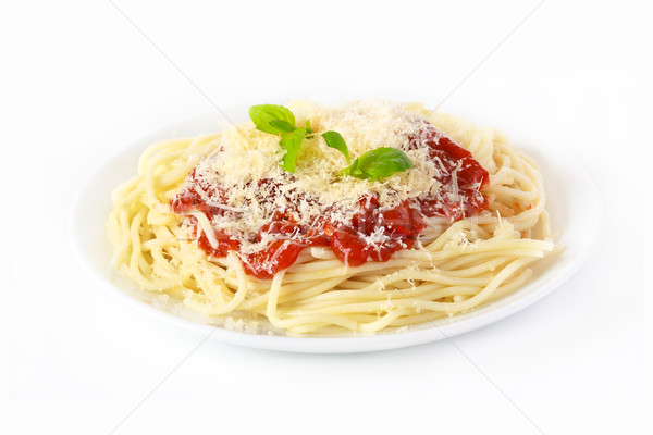 Сток-фото: пасты · томатном · соусе · спагетти · сыра · базилик · лист