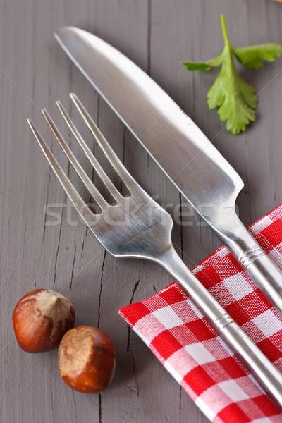 столовое серебро вилка ножом старые деревянный стол ткань Сток-фото © lidante