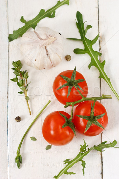 Tomatoes, rucola, garlic and thyme. Stock photo © lidante