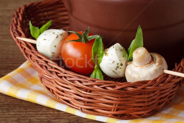 Mozzarella , tomatoes, champignon and fresh basil. Stock photo © lidante