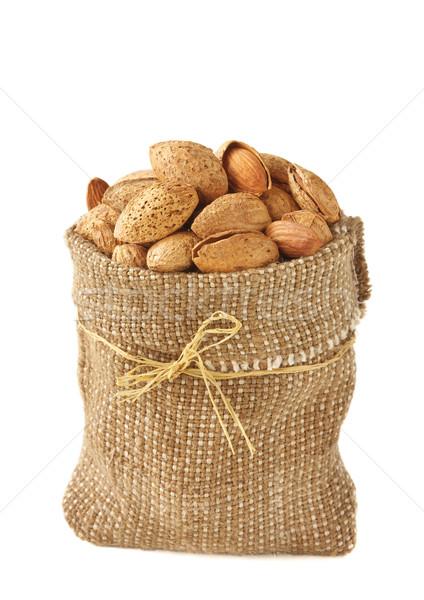 Stockfoto: Amandelen · smakelijk · weefsel · rustiek · zak · voedsel