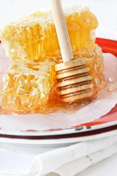 Doce mel vara vermelho rústico prato Foto stock © lidante