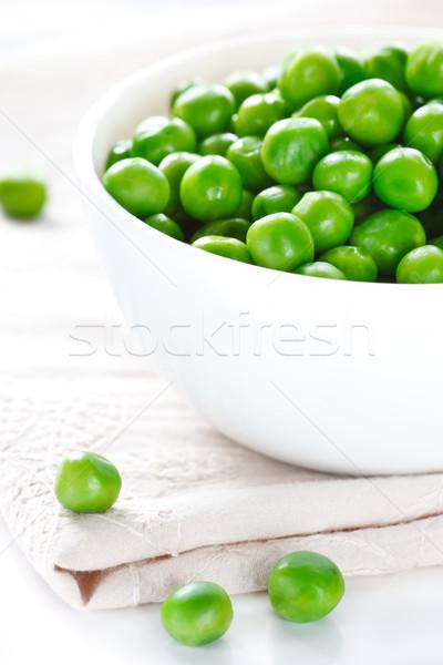 Groene erwten witte keramische kom Stockfoto © lidante