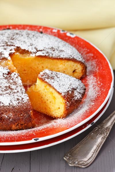 Heerlijk cake oranje rustiek plaat voedsel Stockfoto © lidante