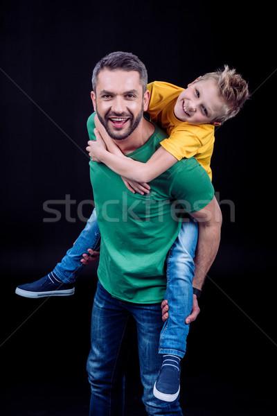 Father piggybacking happy child Stock photo © LightFieldStudios