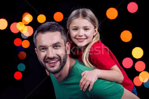 Smiling father piggybacking happy child Stock photo © LightFieldStudios