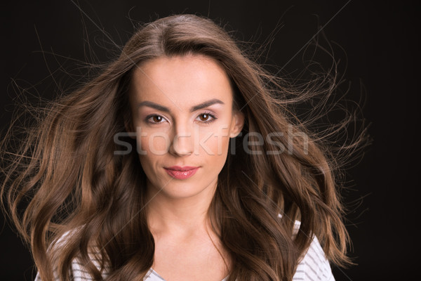 portrait of stylish confident woman looking to camera on black Stock photo © LightFieldStudios