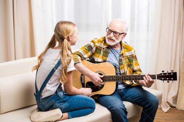 Idős férfi szemüveg tanít aranyos kicsi Stock fotó © LightFieldStudios
