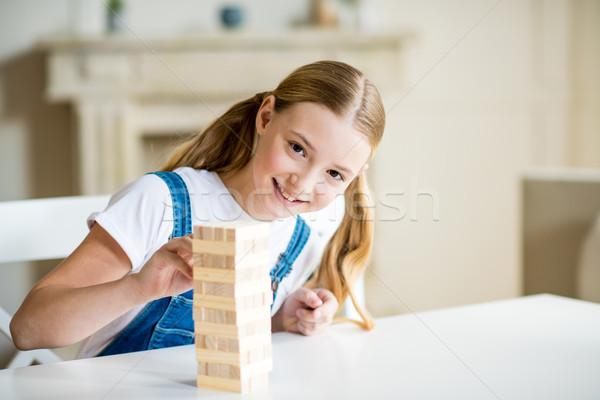çok güzel gülen kız oynama oyun bakıyor Stok fotoğraf © LightFieldStudios