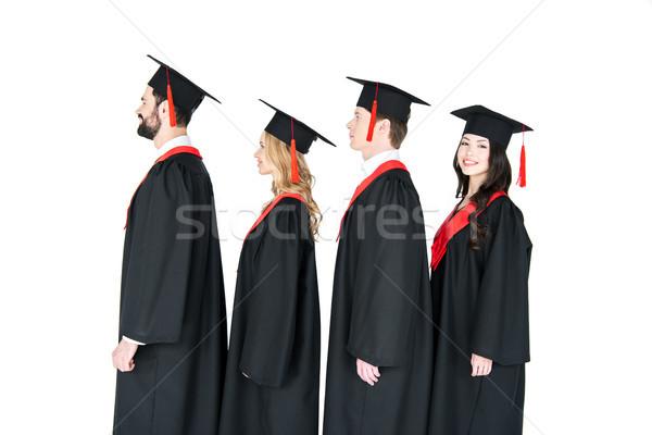Mosolyog diákok érettségi áll csetepaté izolált Stock fotó © LightFieldStudios
