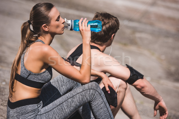 Stock photo: sportive couple resting on slabs