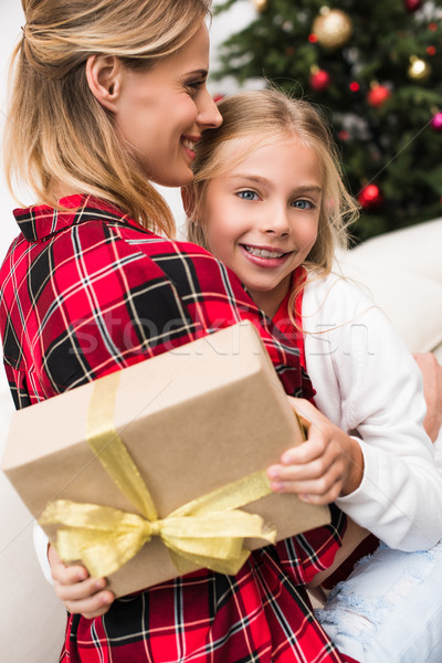 mother and daughter with christmas present Stock photo © LightFieldStudios