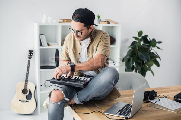 modern dj working with MPC pad Stock photo © LightFieldStudios