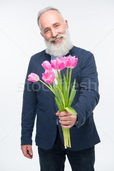 Starszy człowiek tulipany brodaty bukiet Zdjęcia stock © LightFieldStudios