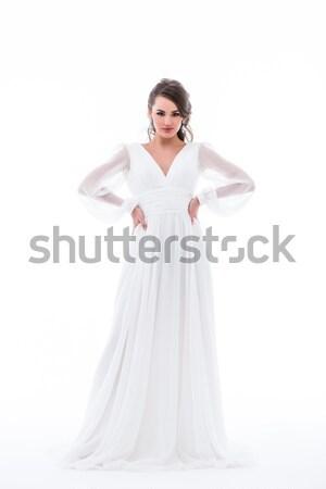 beautiful bride posing in traditional wedding dress, isolated on white Stock photo © LightFieldStudios